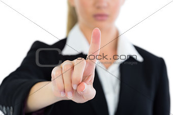 Close up of young businesswoman pointing upwards