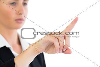 Close up of attractive business woman pointing