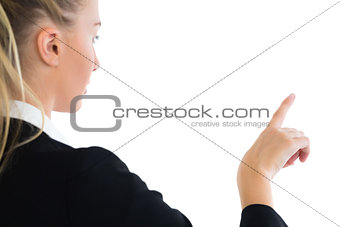 Blonde businesswoman pointing upwards