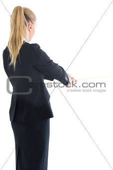 Blonde ponytailed business woman pulling a rope