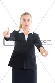 Attractive businesswoman pointing with her hands