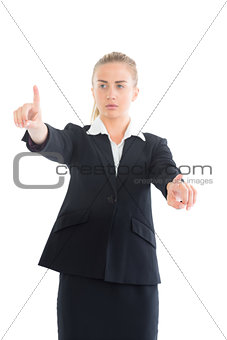 Focused young businesswoman pointing with her hands