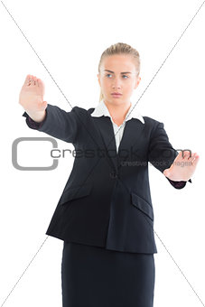 Blonde businesswoman showing with her hands