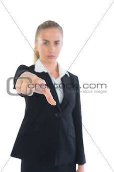 Attractive businesswoman pointing at camera