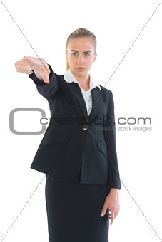 Focused young businesswoman pointing