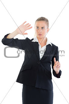 Beautiful young businesswoman presenting with her hands