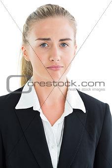 Portrait of sad young businesswoman