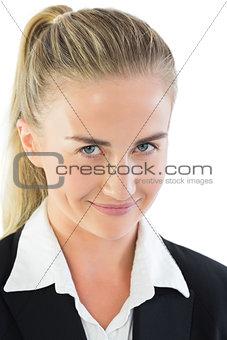 Portrait of impish ponytailed businesswoman