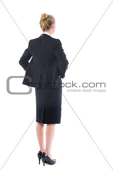Blonde young businesswoman posing with hands on hips