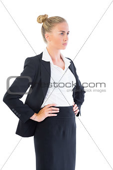 Blonde young businesswoman posing seriously
