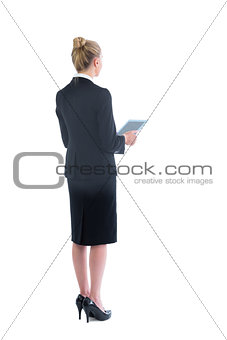Attractive young businesswoman holding her tablet