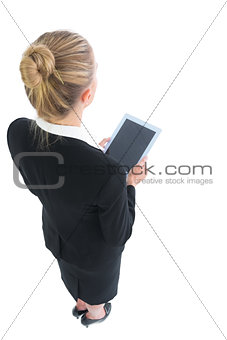 Attractive blonde businesswoman holding a tablet