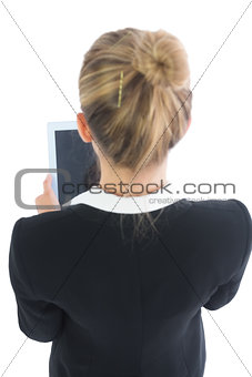 Blonde young businesswoman using her tablet
