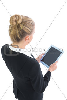 Beautiful blonde businesswoman using her tablet