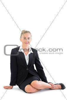 Attractive young businesswoman sitting on floor