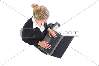 Focused young businesswoman working with her notebook