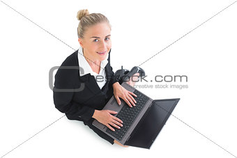 Portrait of beautiful blonde businesswoman using her notebook