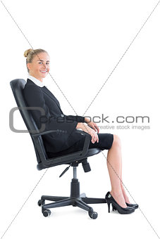Attractive businesswoman sitting on an office chair