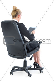 Well dressed young businesswoman sitting on an office chair
