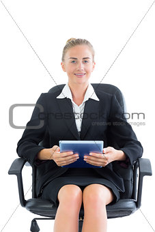 Beautiful young businesswoman holding her tablet