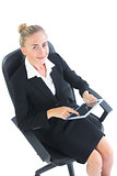 Happy businesswoman sitting on an office chair