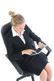 High angle view of concentrated business woman working with her tablet