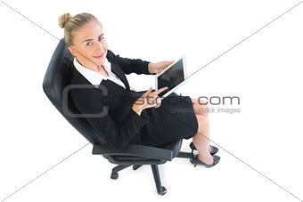 Portrait of blonde cute businesswoman sitting on an chair