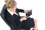 High angle view of beautiful young businesswoman sitting on an office chair