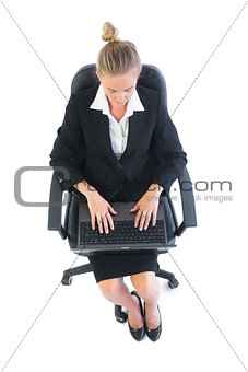 Focused young businesswoman using her notebook