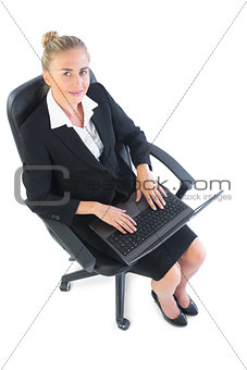 Attractive young businesswoman sitting on an office chair