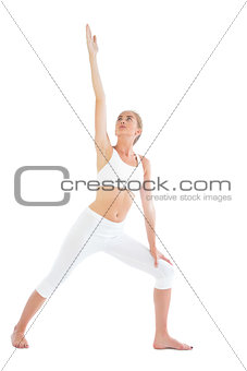 Toned serious blonde doing yoga exercise