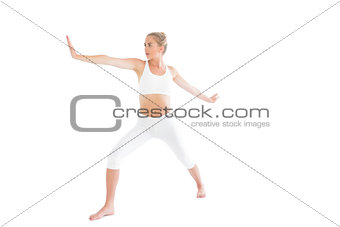 Toned focused blonde doing yoga exercise