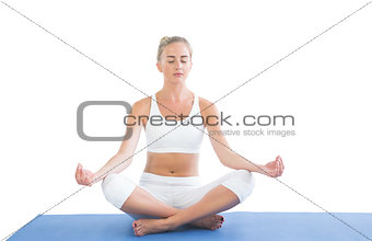 Toned relaxed blonde sitting in lotus pose