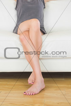 Close up of casual woman sitting on couch
