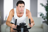 Attractive fit man exercising on bike