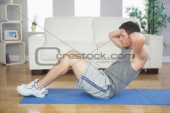 Fit handsome man doing sit ups
