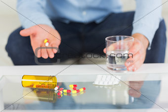Close up of man showing tablets on open hand
