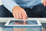 Close up of finger from man touching tablet