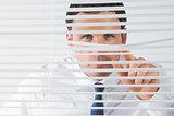 Handsome businessman spying