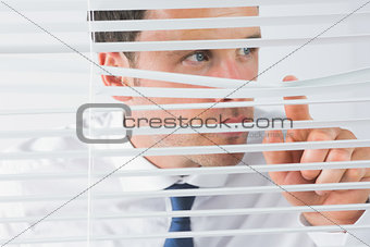 Attractive businessman spying