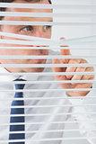 Nice looking businessman spying