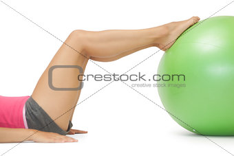 Close up of female legs with exercise ball