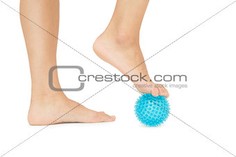 Close up of female feet touching blue massage ball