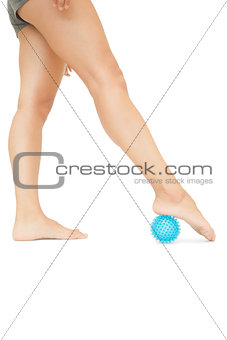 Close up of female legs touching blue massage ball