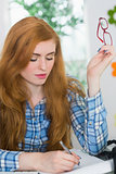 Beautiful redhead writing at her desk