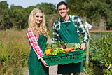 Happy couple showing vegetables
