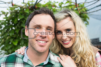 Beautiful young couple in a green house