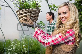 Blonde woman holding a flower basket