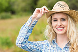 Pretty young woman wearing a straw hat