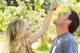 Blonde woman giving her boyfriend a cherry